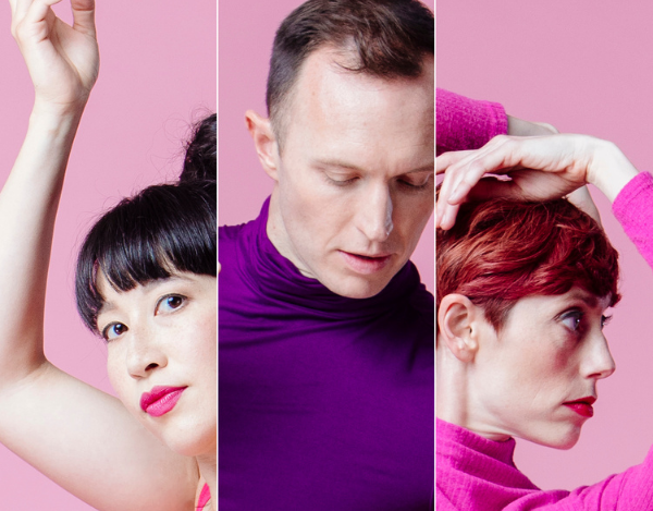 Three individual dancers, wearing brightly colored pinks, purples, and reds, pose for the camera